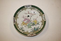 An oriental famille verte plate decorated figures