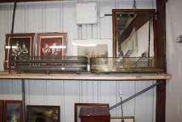 Two antique pierced brass fenders