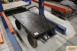 Four wheel turntable hand trolley.