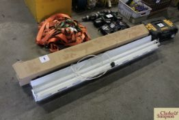 Various fluorescent strip light tubes and holders.