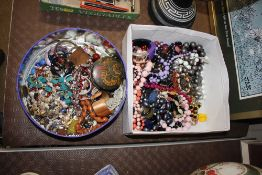 Two boxes of various costume jewellery, beads etc.