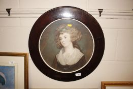 A circular portrait of a young lady
