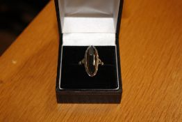 A faceted onyx and white metal mounted dress ring