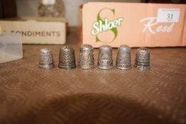Various silver and white metal thimbles