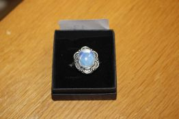 An opaline and white metal mounted ring