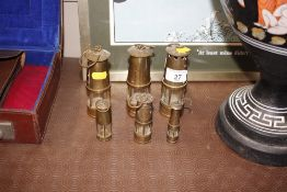 Six miniature brass miners lamps