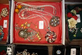 Various costume necklaces, pendants etc.