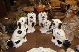 Two pairs of Staffordshire spaniel ornaments