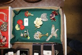 Various vintage brooches depicting cherries, eleph