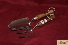 Stainless steel hand trowel and fork.*