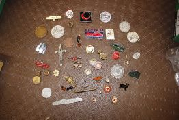 A collection of enamel badges and medals