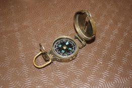 A military style brass compass