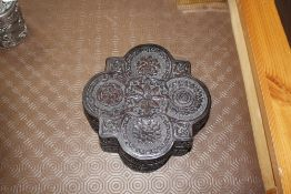 A Chinese carved box and cover
