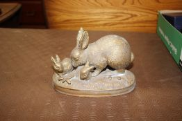 A gilt metal group of a rabbit and youngsters on a