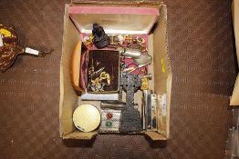A box containing an enamel jar; lighters; cuff-lin