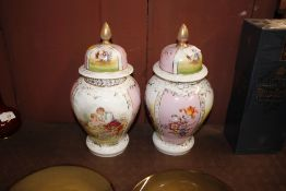 A pair of Dresden style German porcelain vases and