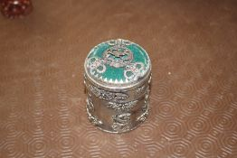 A Chinese white metal jar and cover with jade and