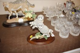 A Country Artists model of a Little Owl pair; and