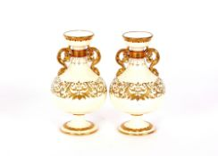 A pair of Minton baluster vases,having rich gilt foliate scroll decoration, 18cm high; and a