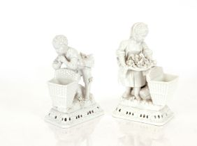 A pair of Meissen blanc de chine posy vases,in the form of children with baskets, having floral