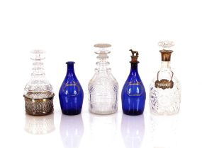 """A cut glass and silver mounted decanter,with silver """"Whisky"""" label; two other hobnail cut ring neck"""