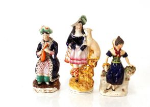 """A Victorian Staffordshire figure,of a highland maid with greyhound; another """"Mora""""; and a seated"""