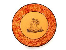 A 19th Century nursery plate, having cherub decoration within an orange sponged border, 18cm
