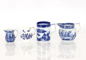 An 18th Century blue and white Englishporcelain mug,decorated in the Chinese manner; a baluster