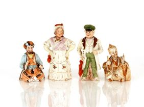 Three Victorian porcelain nodding figures;and a seated China man figure with waving hand (4)