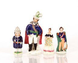 A Staffordshire figure,of man with plumed hat and ermine trimmed cape, 23cm high; a sugar shaker in