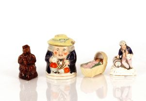 A Staffordshire figure,of a sailor seated by a barrel; a Staffordshire tobacco jar in the form of