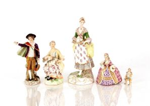 A 19th Century German porcelain figure,of a lady carrying a tea tray, floral decorated and