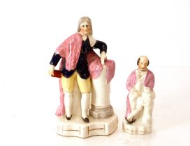 A Victorian Staffordshirefigure of Shakespeare,19cm high; and another of Milton, 20cm high (2)
