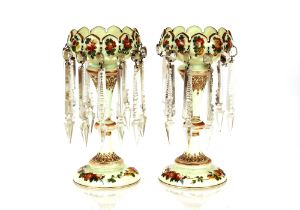 A pair of Victorian pale green opaqueglass lustre vases,having painted foliate spray decoration