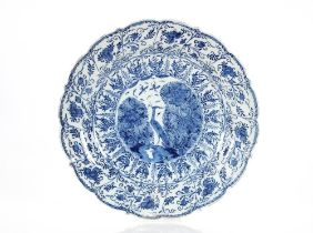 A pair of late 18th Century Delft chargers,central panel decorated with a ho ho bird, surrounded by