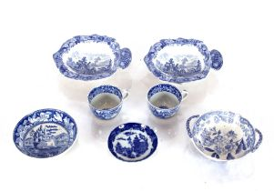 A 19th Century transfer printed miniature tea cup and saucer,decorated rural scenes; a similar cup;