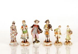 Six various 19th Century German porcelain figures,depicting street vendors, musicians, and a lady