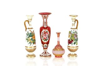 A 19th Century ruby and overlaid glass baluster vase,with profuse floral decoration, 29cm high; a