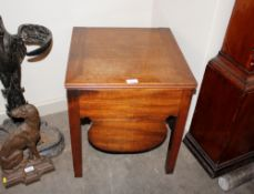 A 19th Century mahogany box commode,raised on square section supports, 46cm wide, 48cm deep, 50cm
