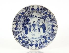 A pair of Chinese shallow bowls,decorated foliate borders and central panels of figures in garden
