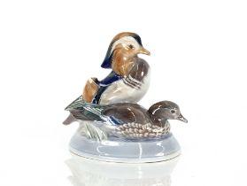 A Royal Copenhagen porcelain study of a Mandarin duck,signed P.Cerdd, 20cm high, 20cm long overall
