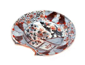 A 18th Century Japanese porcelain barbers bowl,under glazed blue and iron red decoration with