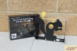 Rocking squirrel target. *
