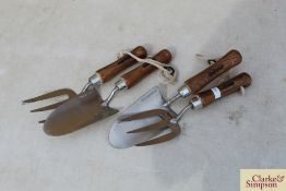 2x stainless steel hand trowel and fork. *