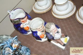 Two 19th Century Staffordshire Toby jugs and a seated Staffordshire figure