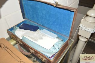 A leather case and contents of Masonic regalia
