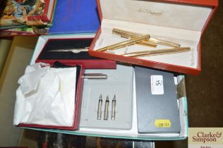A box of various pens to include Dunhill, Parker s
