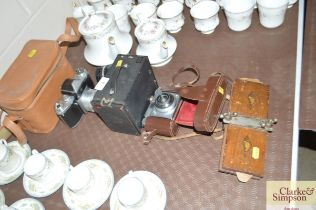 A Practika camera; and a box Brownie camera; and a