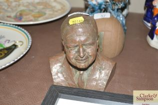 A bronzed bust signed to the back initial A.R.B.S
