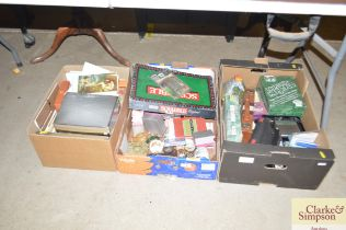 Three boxes containing various games, as new occas